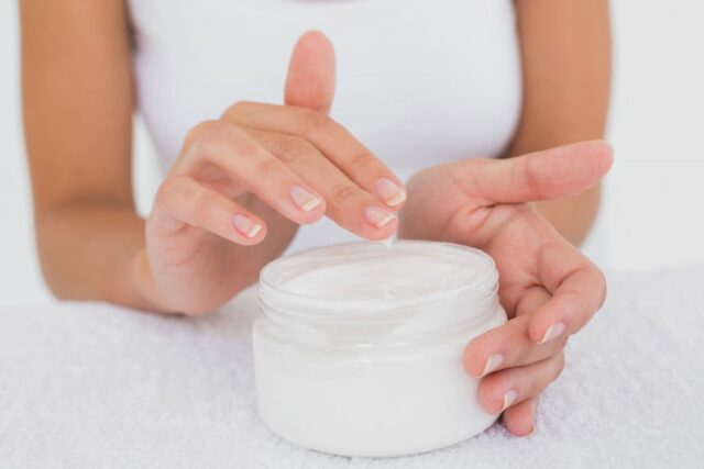 Handcream being used from jar